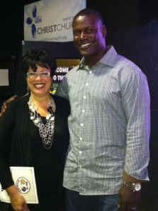 ANB Senior VP, Esther Martinez with Kevin Carter of the Saint Louis Rams