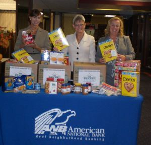 Amy Engelberg, EVP/Chief Lending Officer, Ginger Martin, CEO and President, and Marilyn Bianco, VP Branch Manager with some of the items donated for the food drive.